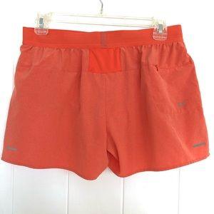 Asics orange athletic shorts size Medium
